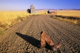 Cowboy Boots on Gravel Road