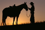 Cowboy Petting Horse at Sunset