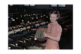 A Young Girl Removes Raw Fiber from Spools to Spindles for Weaving