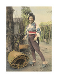 A Japanese Farmer Girl  in Traditional Clothing  Carries a Basket
