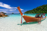 Long Tail Boat on White Sand Beach on Tropical Island