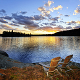 Wooden Chair on Beach of Relaxing Lake at Sunset in Algonquin Park  Canada