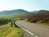 Country Road Winding through the Scottish Highlands Uk