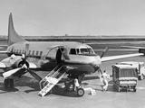 Man Unloading Cargo from Plane