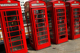 Row of Iconic Red Phone Boxes on the Strand in London