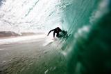 A Male Surfer Pulls into a Barrel While Surfing at Zuma Beach in Malibu  California