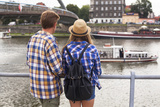 Young Couple on a Journey to Europe  Standing on the Bank of the Vistula  Rear View