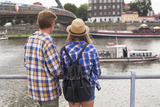 Young Couple on the River Bank in a European City (Rear View) Romantic Journey