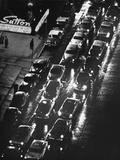 City Sreet w/ Cars on a Rainy Night