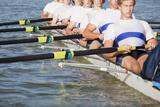 Team of Men Oaring Canoe