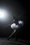 Ballerina Performing on Stage under Spotlight