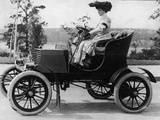 Woman Driving Early Automobile