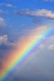 Rainbow with Blue Sky and Clouds