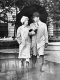 Couple W/Umbrella Walking in the Rain