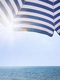 Beach Umbrella and Seascape with Sun Flares
