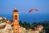 Paraglider Soaring past Tower of Colourful Village Church  Alpes-Maritimes  Roquebrune  Provence-Al