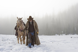 Cowboy Walking His Horse and Holding a Shotgun