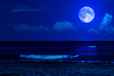 Midnight Sea Landscape with a Full Moon and Waves Breaking on the Beach