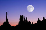 Dawn Silhouette of the Totem and Yei Bi Chi Formations with Large Full Moon in Monument Valley  Ari