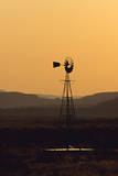 A Desert Windmill at Sunset