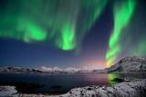 Northern Lights and Moonlit Landscape