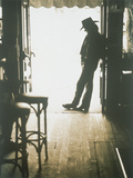 Cowboy Leaning in Doorway