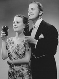 Couple Dressed up Holding Drinks