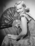 Portrait of Blonde Woman Holding Fan