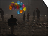 Afghan Boy Runs with Balloons to Join His Friends in Dusty Alley in Kabul  Afghanistan