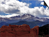 The Sun Breaks Through the Clouds to Highlight the Summit of Pikes Peak