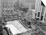 With the Famed Rockefeller Center Christmas Tree Rising Above Them  Skaters Glide on the Ice