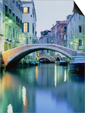Bridge above a channel in Venice  evening shot
