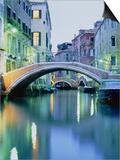 Bridge above a channel in Venice  evening shot