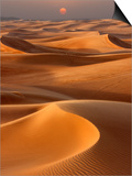 Sunset over the sand dunes in Dubai