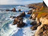 Natural rock arch in surf at Garrapata State Park