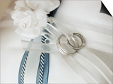Wedding rings tied to pillow