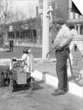 1920s Little Girl Standing Beside Her Pedal Car Asking for Gasoline