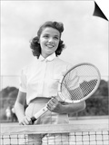1940s-1950s Woman Posing with Tennis Racket on Tennis Court Near Net