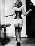 Young Woman Lacing Her Corset