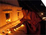 Monk Lighting Butter Lamps at Boudnath  Kathmandu  Nepal