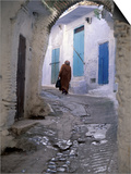 Traditionally Dressed Woman along Cobblestone Alley  Morocco
