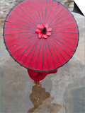 Novice Monk Holding Alms Woks with Red Umbrella  Bagan  Myanmar