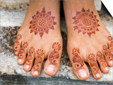 Henna Painting on Feet of Young Girl
