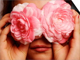 Young Girl Holding Camellia Flowers over Her Eyes