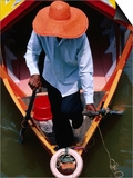 Helmsman Manoeuvres Sampan or Ferry on Sarawak River  Kuching  Sarawak  Malaysia