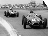 Graham Hill Leads in his Lotus 16 from Jack Brabham in Cooper T45  1958 British Grand Prix