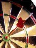 Dart in Bull's Eye of Dart Board