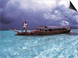 Bajau Fisherman in Traditional Lepa Boat with Rain Clouds Behind  Pulau Gaya  Borneo  Malaysia
