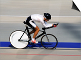 Action of Female Cyclist Competing on the Velodrome