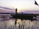 Man Standing in Boat Fishing